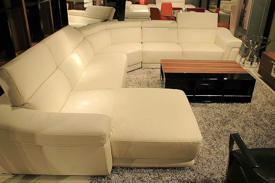 Leather sofa furniture - Leather Sectional With Adjustable Headrest At An Affordable Price